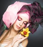 Young lady with orchids Royalty Free Stock Photography