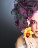 Young lady with orchids Stock Photo