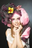 Young lady with orchids Royalty Free Stock Photos