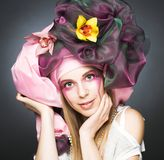 Young lady with orchids Royalty Free Stock Images
