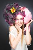 Young lady with orchids Royalty Free Stock Image