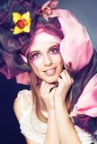 Young lady with orchids Stock Images