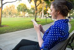 Young lady outside in a park stock photo