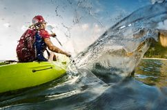 Young lady paddling hard Stock Images