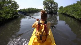 Young lady paddling hard  the sea kayak with lots. Young lady paddling hard the sea kayak with lots of splashes stock footage
