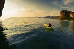 Young lady paddling the kayak Royalty Free Stock Photos