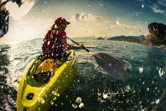 Young lady paddling the kayak Stock Photography