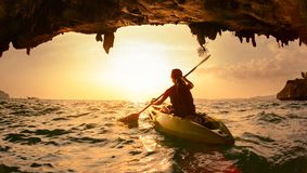 Young lady paddling the kayak Stock Images