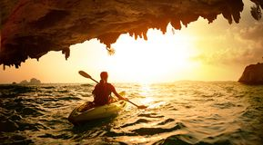 Young lady paddling the kayak Royalty Free Stock Image