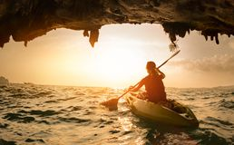 Young lady paddling the kayak Stock Photos