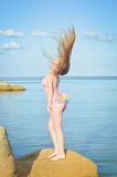 Young lady with perfect figure sunbathing standing Stock Photography