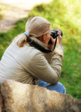 Young lady photographer. The keen photographer Royalty Free Stock Photography