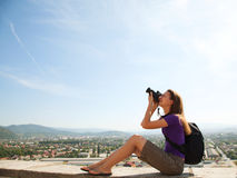 Young lady photographer outdoors Royalty Free Stock Images