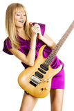 Young lady playing an electric guitar Royalty Free Stock Photos