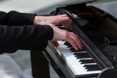 Young lady playing electric piano Royalty Free Stock Image