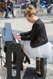 Young lady playing electric piano at Aristotelous square Royalty Free Stock Image