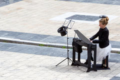 Young lady playing electric piano at Aristotelous square Royalty Free Stock Photography