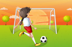 A young lady playing football Stock Photo