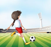 A young lady playing football Royalty Free Stock Photos