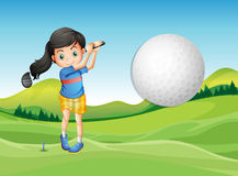 A young lady playing golf Stock Images