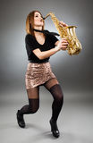Young lady playing the saxophone Royalty Free Stock Photography