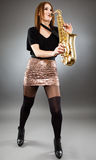 Young lady playing the saxophone Royalty Free Stock Photos