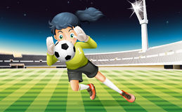 A young lady playing soccer Stock Image