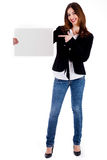 Young lady pointing at blank board Stock Photos