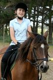 Young Lady on Pony. Portrait of a young teenager sitting on her pony Royalty Free Stock Photography