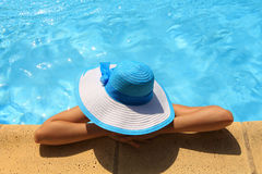 Young lady by the poolside Stock Photo