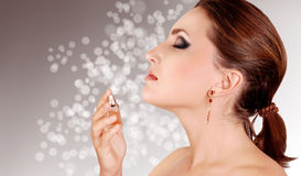 Young lady portrait with perfume Royalty Free Stock Image