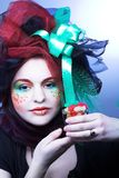 Young lady portrait. Young woman in creative cloth with sweets Stock Photos