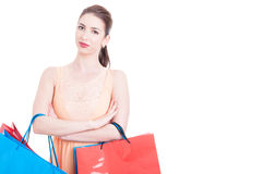 Young lady posing confident holding shopping bags Royalty Free Stock Image