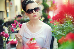Young lady posing with fancy dessert. Young lady posing with fancy fruit dessert Stock Images
