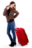 Young lady posing with luggage Stock Photography