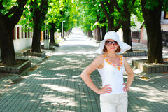 Young lady posing on pave alley Stock Photos
