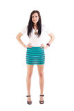 Young lady posing in short skirt. Beautiful young lady posing in short skirt. Isolated over white background Royalty Free Stock Photography
