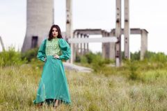 Young lady posing somewhere in industrial ruins Royalty Free Stock Photo