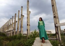Young lady posing somewhere in industrial ruins Royalty Free Stock Photos