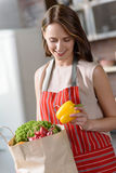 Young lady preparing to cook healthy food Royalty Free Stock Images
