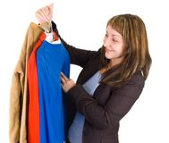 Young lady purchasing clothes. Isolated on white Stock Photos