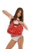 Young lady with purse Royalty Free Stock Images