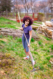 Young lady with rake spring cleaning the garden Royalty Free Stock Image