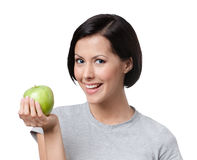 Young lady with a green apple Royalty Free Stock Images