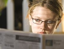Young lady reading stock image