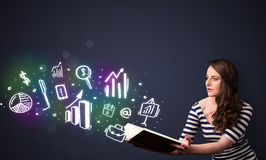 Young lady reading a book with business icons Royalty Free Stock Image