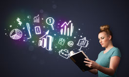 Young lady reading a book with business icons Stock Photography