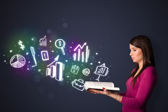 Young lady reading a book with business icons Royalty Free Stock Photo