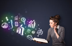 Young lady reading a book with business icons Stock Images