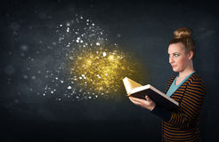 Young lady reading a magical book Royalty Free Stock Image